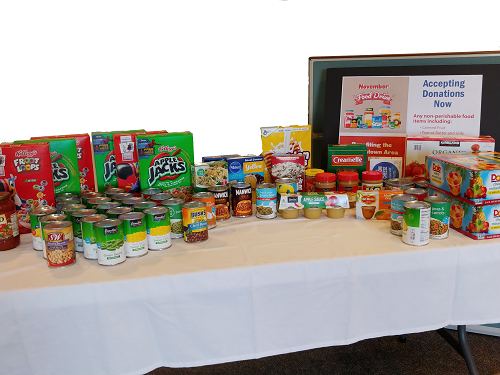 Join our food drive, drop off donations at either bank office.